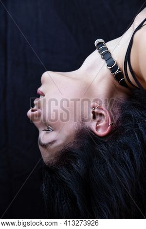 White European Woman With Dark Hair Close-up Portrait Isolated On Black