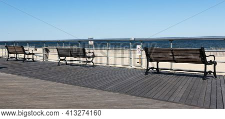 Three Park Benches On The Boardwalk At Sunken Meadow State Park Looking At The Long Island Sound On
