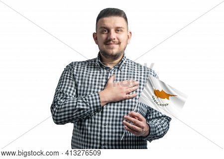White Guy Holding A Flag Of Cyprus And Holds His Hand On His Heart Isolated On A White Background Wi