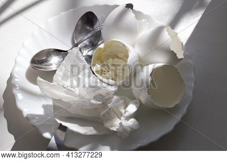 Ending Of Morning Meal: Shells Of Soft-boiled Eggs With The Remains Of The Yolk And The Cooked Egg W