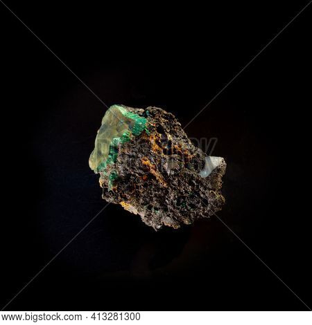 Malachite Inside Chalcedony Mineral Isolated On Black Background. For Geology Or Mineralogy Websites