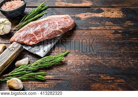 Raw Picanha Or Top Sirloin Cap Steak On A Meat Cleaver. Dark Wooden Background. Top View. Copy Space