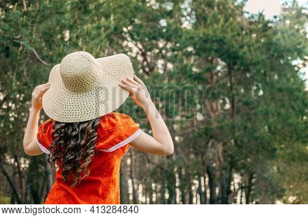 Enjoying The Nature, Wellness, Wellbeing, Healthy Lifestyle, Slow Living. Young Brunette Girl In Red