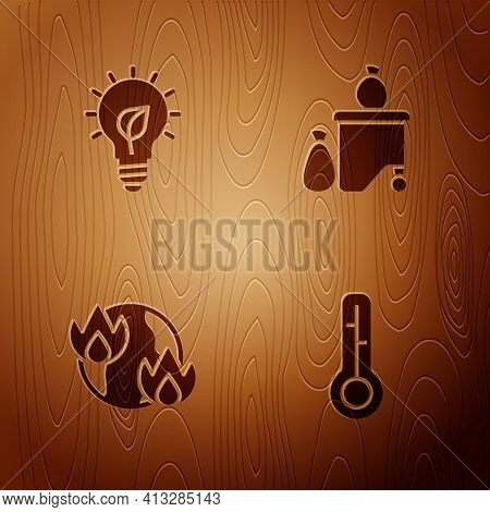 Set Meteorology Thermometer, Light Bulb With Leaf, Global Warming Fire And Full Dustbin On Wooden Ba