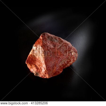 Raw Red Feldspar Mineral Nugget From Tian Shan Mountains Isolated On Black Background. For Geology M