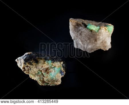 Raw Emerald Gemstone Crystals Inside Feldspar Rock With Molybdenite, Mica And Apatite Inclusions Iso