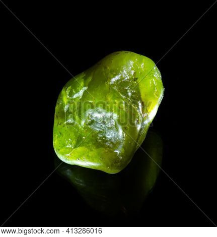 Raw Green Nephritis Jade Mineral Nugget From Austria Isolated On Black Background. For Geology Miner