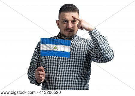 White Guy Holding A Flag Of Nicaragua And A Finger Touches The Temple On The Head Isolated On A Whit