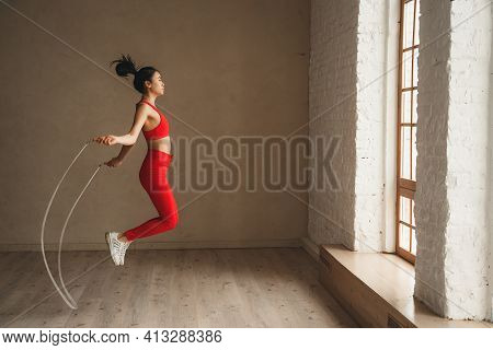 Woman Is Jumping Rope, Workout At Health Club. Sporty Attractive Female Working Out. Healthy Lifesty
