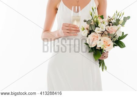 Cropped View Of Fiancee Holding Champagne And Wedding Bouquet Isolated On White.