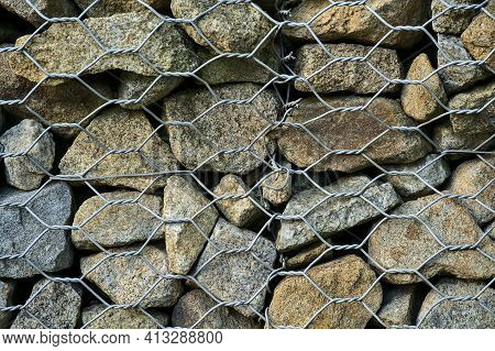 Beautiful Close Up High Resolution View Of Gabion Wall Rocks And Stones In Metal Wire Box Cage Along