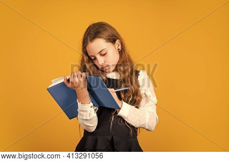 Study Today. Little Child Write In Study Book. Small Girl Do Study Records. School And Education. Pr