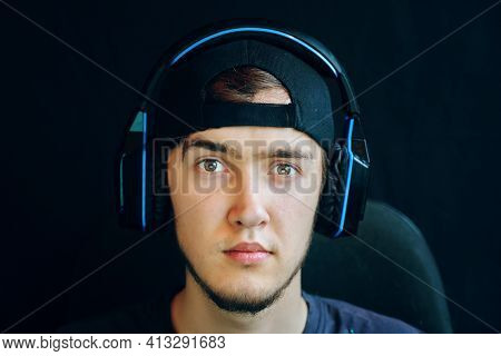 Cyber Sport. Professional Cybersport Player Training Or Playing Online Game On His Pc. The Guy With