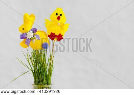 Decorative Fleece Easter Yellow Bunny And Chicken On A Vase With Grass. Easter Background