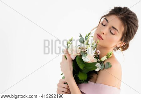 Young Fiancee Holding Wedding Bouquet While Posing With Closed Eyes Isolated On White.