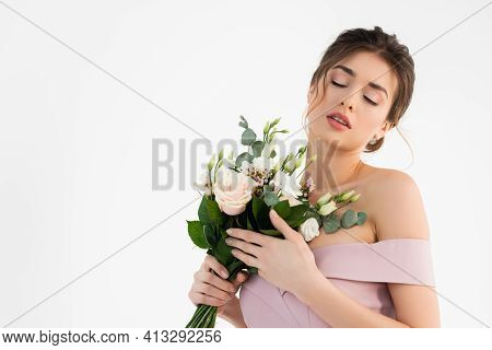 Sensual Fiancee Holding Wedding Bouquet While Posing With Closed Eyes Isolated On White.