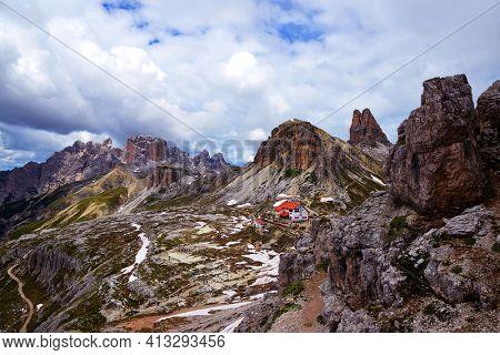 Parco Naturale Tre Cime, Italy - July 05, 2013: Beautiful landscape in Tre Cime di Lavaredo National park with Rifugio Locatelli mountain chalet.