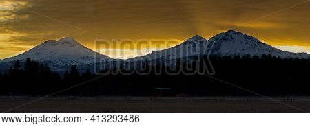 The View Of Mt Bachelor And The Three Sisters From Sisters Oregon During Sunset, Cascade Mountain Ra