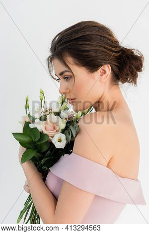 Charming Fiancee Posing With Wedding Bouquet Isolated On White.