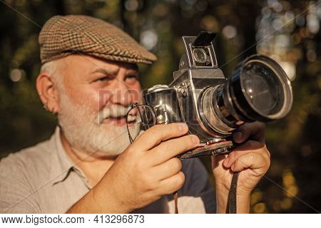 Pension Hobby. Experienced Photographer. Vintage Camera. He Likes Birdwatching. Old Man Shoot Nature