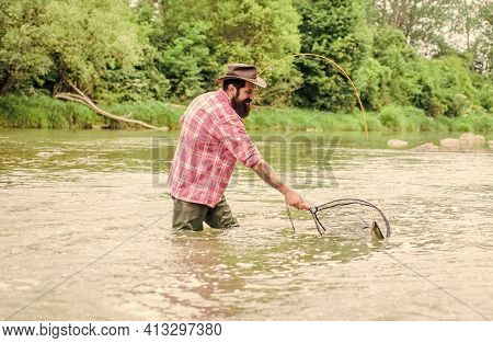 In The Zone Fishing. Hobby And Sport Activity. Pothunter. Fisherman With Fishing Rod. Bearded Fisher