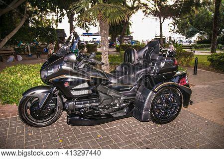 Alanya , Turkey- October 20, 2020: Three wheel motorcycle presented on street  in Alanya, Antalya district, Turkey, Asia