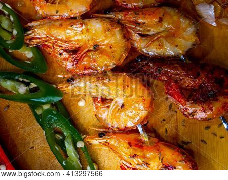 Delicious Fried Prawns On A Skewer With Sauce And Lemon