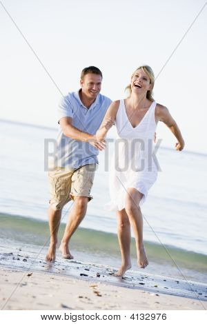 Couples At The Beach Playing And Smiling