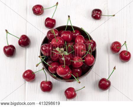 Fresh Cherry On Plate On Wooden White Background. Fresh Ripe Cherries. Sweet Cherries.