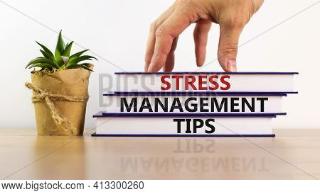 Stress Management Tips Symbol. Books With Words 'stress Management Tips'. Beautiful White Background