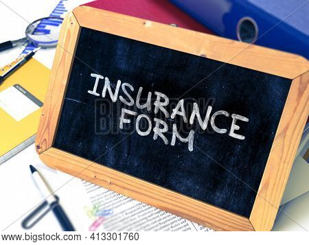 Insurance Form Handwritten On Chalkboard. Composition With Small Chalkboard On Background Of Working