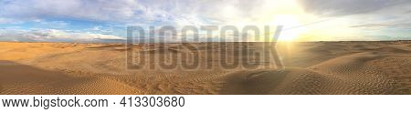 Majestic Panorama Of Landscape In The Sahara Desert, Tunisia. Sun With Bright Rays Over The Desert H