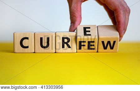 Curfew And Cure Symbol. Businessman Turns Cubes And Changes The Word 'curfew' To 'cure'. Beautiful W