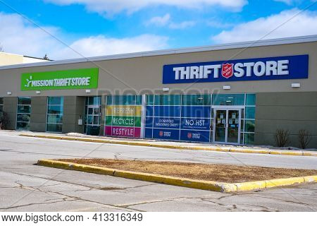Ottawa, Ontario, Canada - March 14, 2021: Two Side-by-side Christian Thrift Stores, The Mission Thri