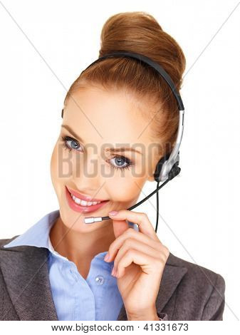 Closeup head and shoulders portrait of a beautiful woman receptionist or call centre operator with a headset isolated on white