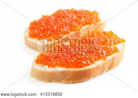 Two loaves of bread with red salmon roe isolated on white background
