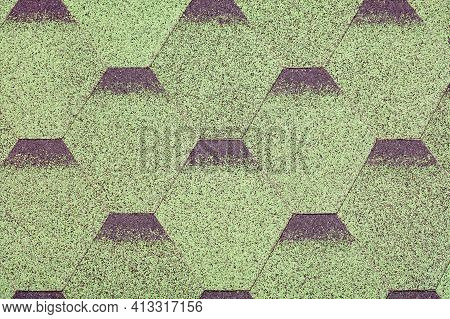 The Roof Is Made Of Diamond-shaped Green Bitumen Plates Overlapping Each Other. Background And Textu