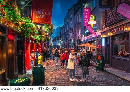 Dublin, Ireland, August 2019 Crowds of people having good time at Temple Bar street, famous for its pubs, restaurants and nightlife, night photography
