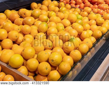 Bunch Of Oranges In Supermarket. Crates Full Of Ripe Mandarin And Clementines, Oranges For Sale At T