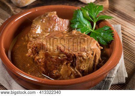Braised Pork Neck In Own Sauce. Shallow Depth Of Field.