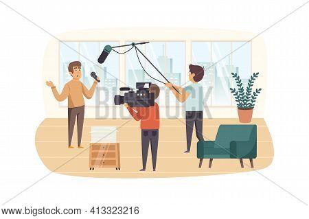 Journalist And Film Crew Filming Reportage Indoors Scene. Presenter Tells News, Operator Records Vid