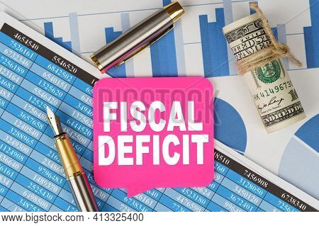 Business And Finance Concept. Among The Financial Statements And Charts Is A Note With The Text - Fi