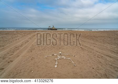 Skeleton Coast In Namibia. The Shipwreck Was Stranded Or Grounded At The Coastline Of The Atlantic C