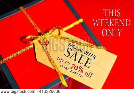 Special Offer Sale Up To 70 Percent Off, Limited Quantities - Text On Gift Box Label, Red Background