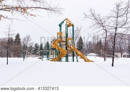 A Snowing Playground In The Iberville Park Of Quebec City.