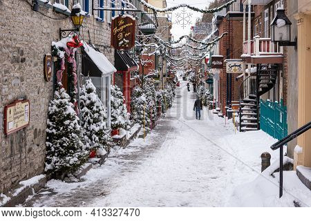 Quebec City, Quebec, Canada - 17 January 2021:  The Petit Champlain Street Under The Snow In The Ol