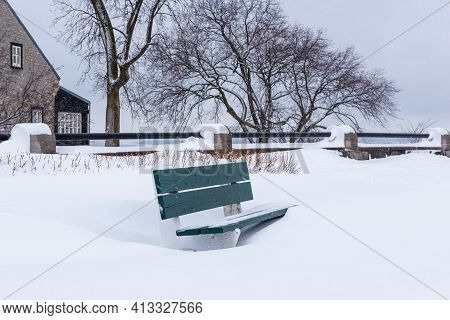A Bench Under The Snow In A Park Of The Old Quebec City