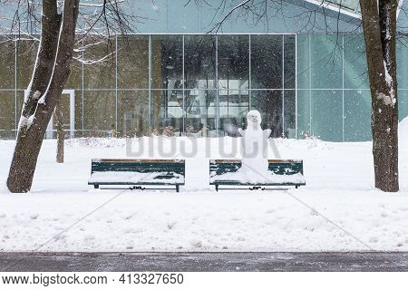 A Snowman On A Bench Under The Snow In The Park Of The Abraham Plains Battlefield In Quebec City.