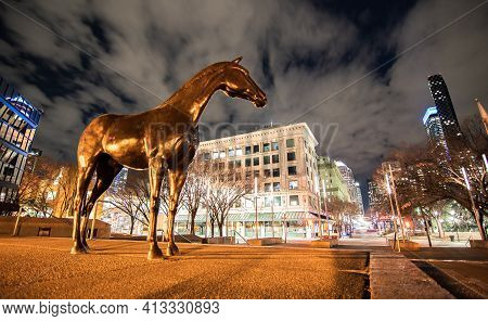 Calgary Alberta Canada, March 15 2021: A Horse Statue Standing At A Downtown Plaza Around Downtown L