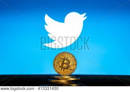 Bitcoin On A Stack Of Coins With Twitter Logo On A Laptop Screen. Slovenia, Ljubljana - 24 02 2019: